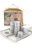 House made of dollars with silver coins Royalty Free Stock Photography