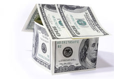 House made from dollars on white background Stock Photo