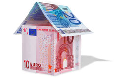 House made with Euro banknotes. Photo of a model house made from Euro banknotes, isolated on white with a clipping path so you can remove the shadow and drop Stock Image