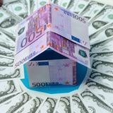 House made of Euro banknotes, in a circle dollar. In the circle the dollar, a house made of Euro banknotes Stock Photo