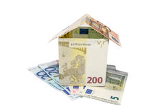 House made from euro bills isolated Stock Image