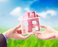 The House made from EURO in the Hand Royalty Free Stock Photo