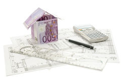 Money house on an architectural building plan. House made of 500 Euro money on an architectural building plan. Isolated on a white background Royalty Free Stock Photos