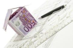 House made of 500 Euro money on blueprint Stock Photos