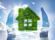 House made of grass on blue sky Stock Photo