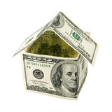 House made of hundred dollars notes. Isolated on white. Concept of a mortgage, hypothec, deposit, saving, investment, etc Royalty Free Stock Photo