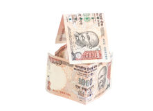 House Made of Indian 1000 rupee banknotes. Isolated on white Royalty Free Stock Photography