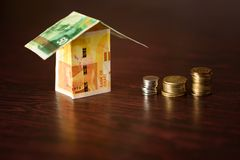 House made from Israel money over wood background. House made out of Israel money over wooden background stock photography