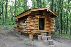 House made of logs. The hut on the legs of the wooden logs Stock Photo