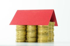 House made from coins and red color roof Stock Photography