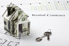 House made of money and the keys to a new home Royalty Free Stock Photography