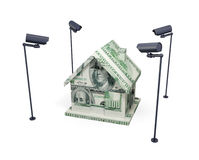 House made of money and observation cameras. Royalty Free Stock Photos