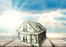 House made of money on wooden surface Stock Images