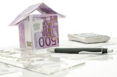 House made of money on a working desk Stock Images