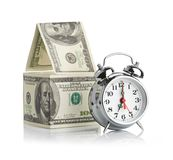House Made Of Dollars And Alarm Clock. Stock Photography