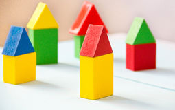 House made of old cubes. Wooden colorful building blocks. Vintage childrens toys. the concept of building a house, apartments for Stock Photography