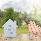 House is made of paper with the words home. Stock Image