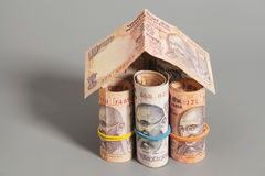 House Made Roll of Indian rupee banknotes. Isolated on gray Stock Photography