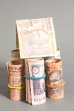 House Made Roll of Indian rupee banknotes. Isolated on gray Royalty Free Stock Photo