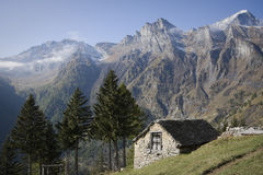 House made of stone on the alps Royalty Free Stock Photo
