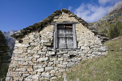 House made of stone on the alps Royalty Free Stock Photos