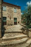 House made of stone with large steps and wooden door stock images