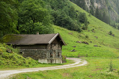 house made of stone in mountains of Alps Stock Photos