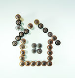 House made from used batteries Stock Photo