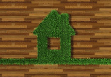 House made of wood and grass. House from the grass on a parquete Royalty Free Stock Photos