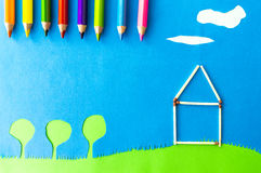 Children`s play:home sweet home. House made of wooden matches on blue background Stock Photography
