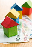 House made from wooden toy blocks with euro money Stock Photos
