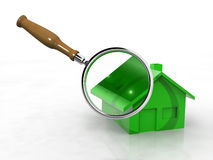House and magnify glass Stock Photos