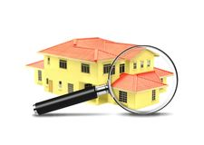 House and Magnifying Glass Stock Image