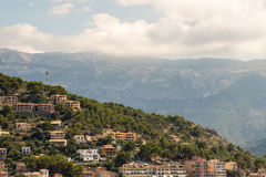 House on a mallorcan mountain  with bigger mountain in the backg Royalty Free Stock Photography