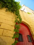 Simple Mediterranean house with red door royalty free stock image