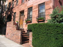 House in Manhattan. Manhattan red bricks house with stairs Stock Image
