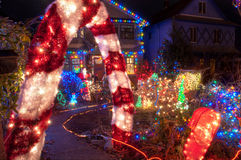House with Many Colorful Christmas Lights. House with entire front yard covered in colorful Christmas lights stock photography