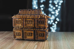 The house of matches. On the table is a house of matches, behind garlands, bokeh beautiful Christmas Royalty Free Stock Photography
