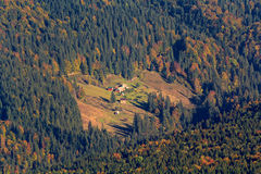 House in the meadow on a wooded hillside. Carpathians royalty free stock photos