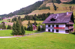 House in the meadows of Switzerland Stock Photography