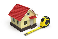 House and measuring tape Stock Photos