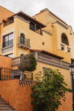 House. Mediterranean house - yellow facade - balconies Royalty Free Stock Photography