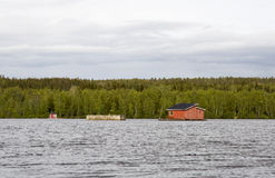 House in the middle of River in Umea, Sweden Royalty Free Stock Images