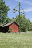 House and midsummer tree Stock Photos