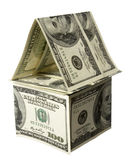 House miniature. Close up of miniature house  built of paper currency on white background with clipping path Royalty Free Stock Photography