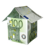 House miniature. Close up of miniature house  built of paper currency on white background with clipping path Stock Photography