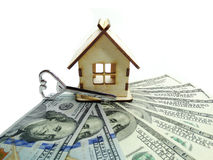 House miniature and key on money background savings concept Royalty Free Stock Photography