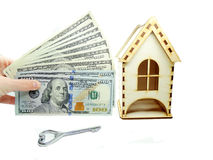 House miniature key money in hand savings concept Royalty Free Stock Images