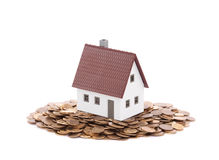 House miniature with pile of coins Stock Photography