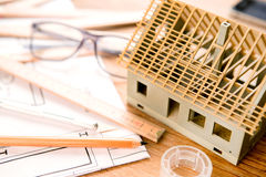 House miniature under construction on an architect desk Royalty Free Stock Photo